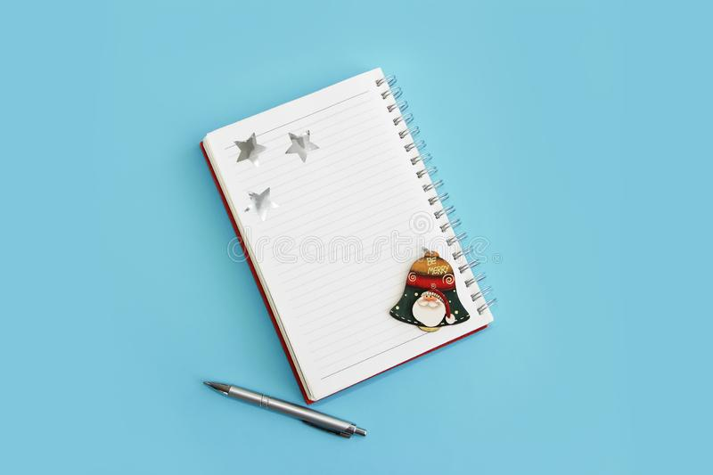 Business notepad for spiral notes, stationery pen and christmas decor for new year holiday royalty free stock photo