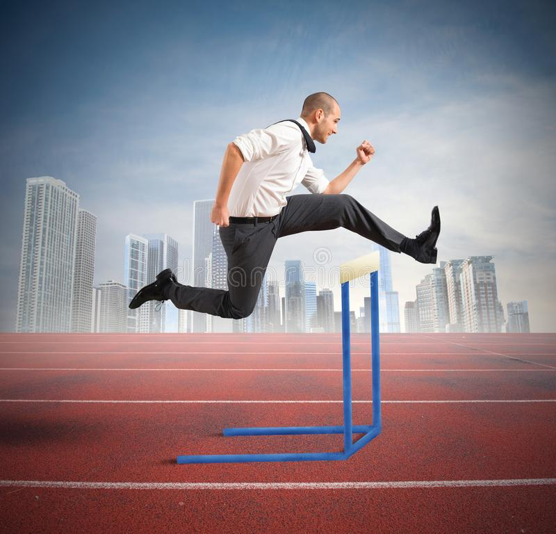 Business obstacle. Concept of business difficulty with jumping businessman stock image