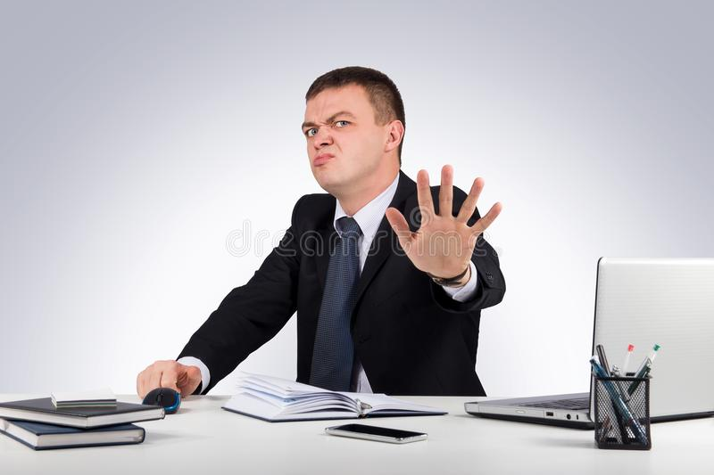 Funny buisnessman making stop gesture on gray background royalty free stock photos