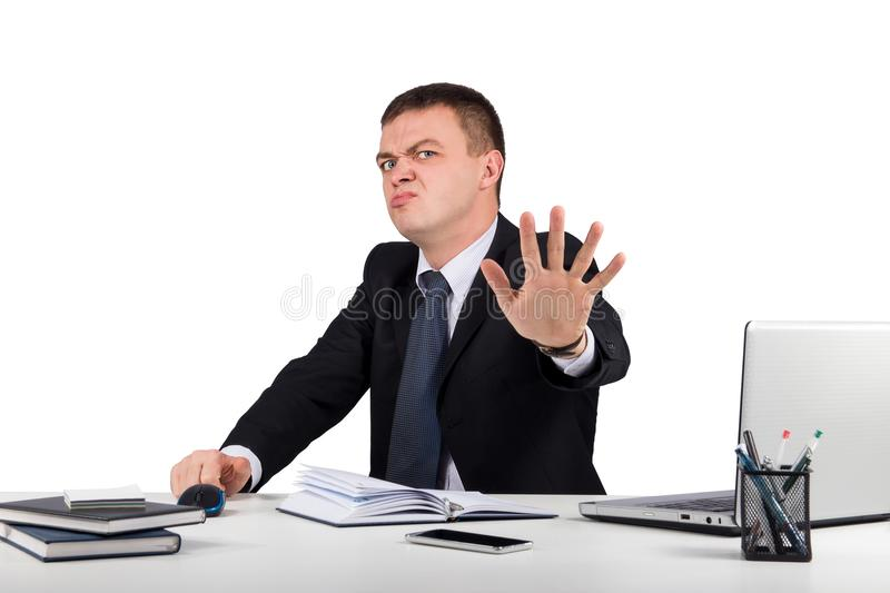 Funny buisnessman making stop gesture isolated on white background stock photography
