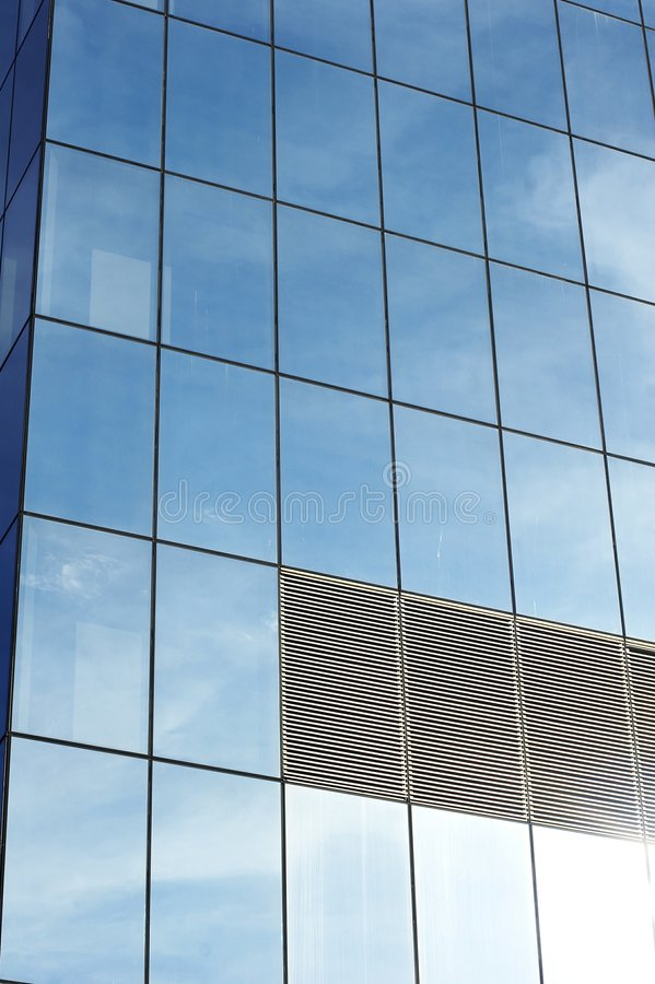 Business office building. Glass office building with reflection of sky royalty free stock photography
