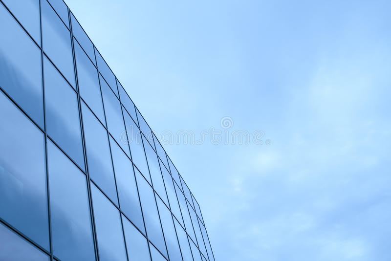 Business office building exterior with glass windows royalty free stock images