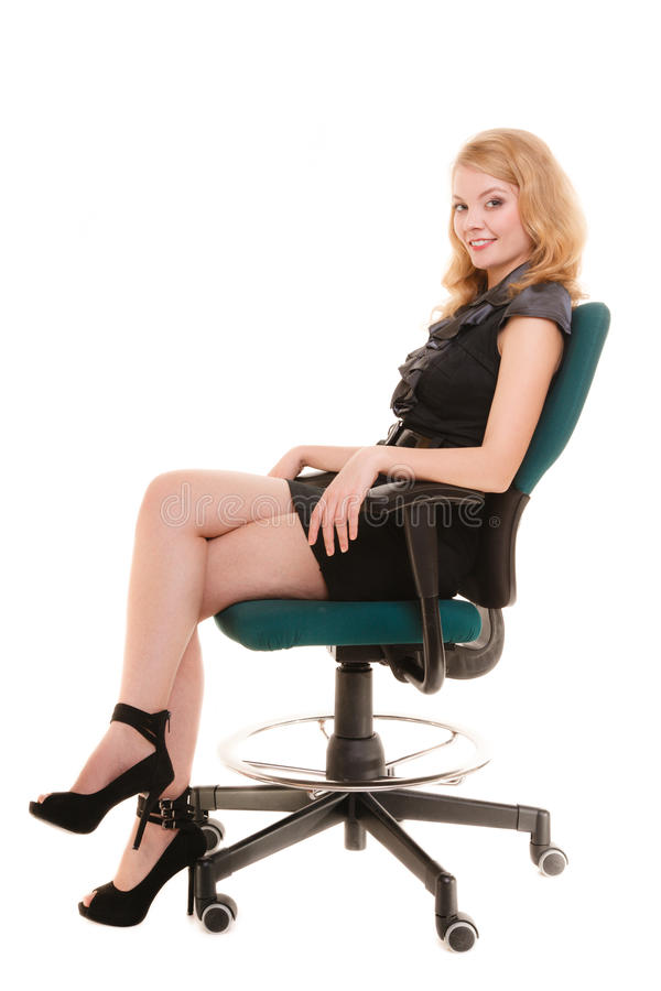 Business office concept - businesswoman sitting on a chair. Business and office concept - elegant businesswoman in full length sitting on a chair. Isolated stock image