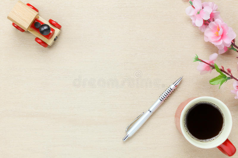 Business office desk background.The silver pen coffee b. Top view business office desk background.The silver pen coffee beautiful pink flower toy car on wooden stock photos