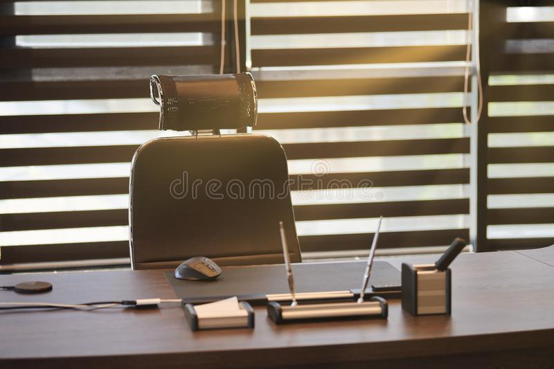 Business office workplace. Sunlight at work place for chief, boss or other employees. Table and comfortable chair. Light through royalty free stock images
