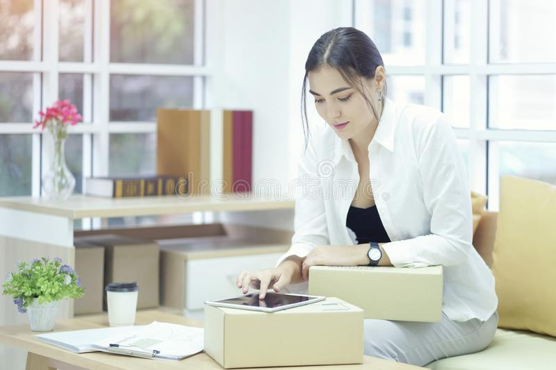 Business owner using tabtet computer confirm and check packing list order, Pack boxes, Shipping parcel package and Delivery. Shopping online royalty free stock photos