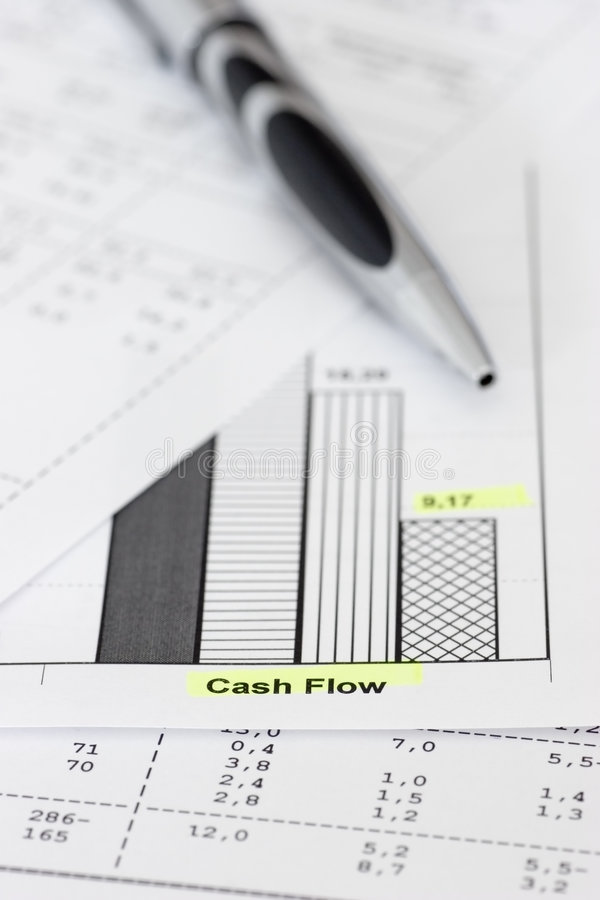 Business papers and ballpen. Business papers with ballpen focus on the words cash flow stock photo