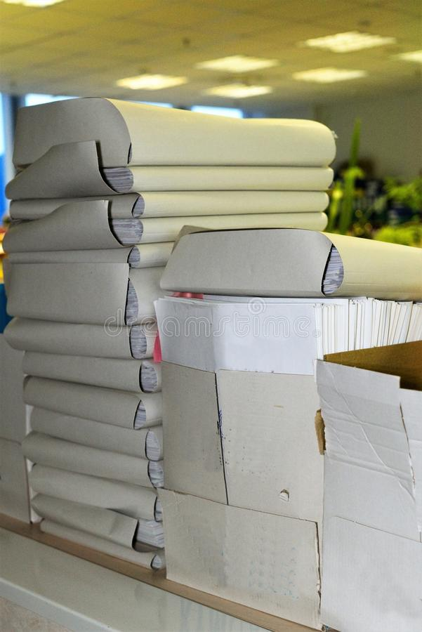 Business papers in folders in the office on the shelves. Cardboard folders with financial documentation in the business center with artificial lighting, work stock photos