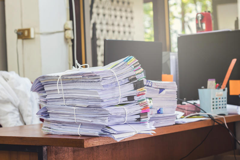 Business papers pile reports stock photos