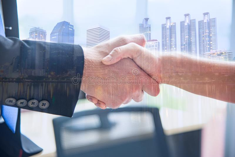 Business partner or coorperation concept. Closed up business man and woman shaking hands after finished meeting up. stock photo