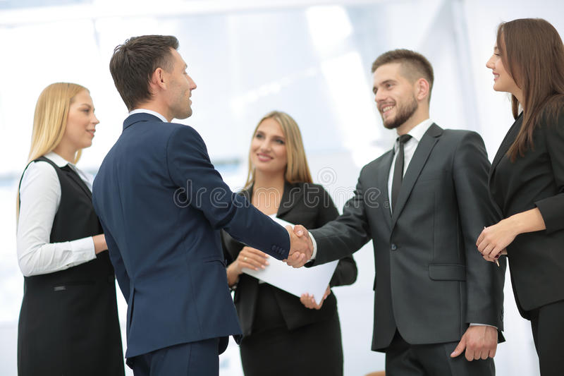 Business partner greeting each other with handshake royalty free stock image