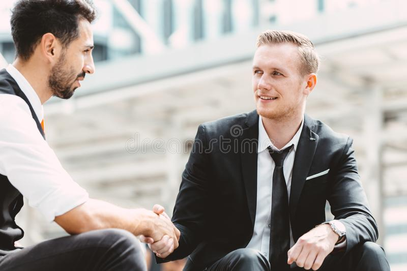 Business partner handshake happy smile positive deal. Project together royalty free stock image