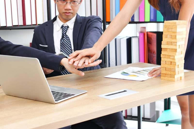 Business partner joined hand together to greeting complete dealing in office. Success and teamwork concept stock photography