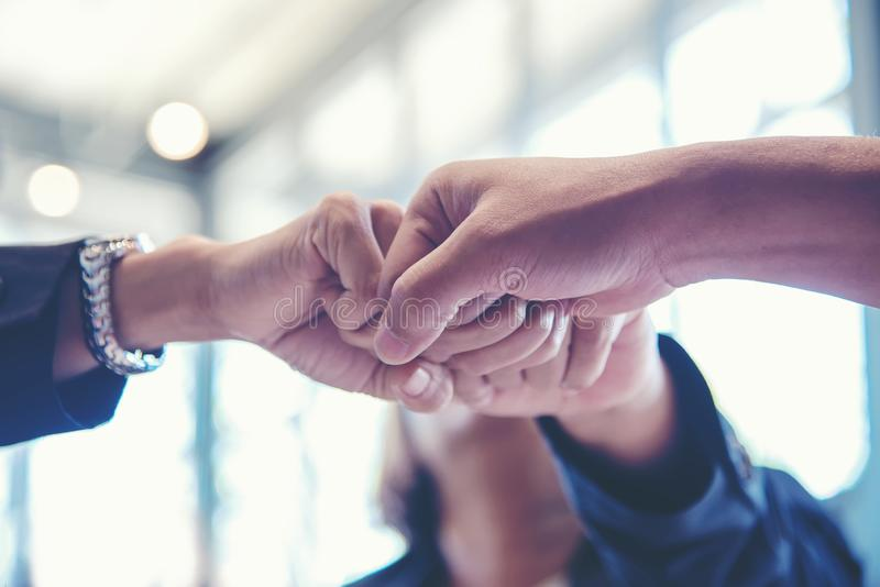 Business partner people joining and stack hand together after contract finished meeting. stock photo