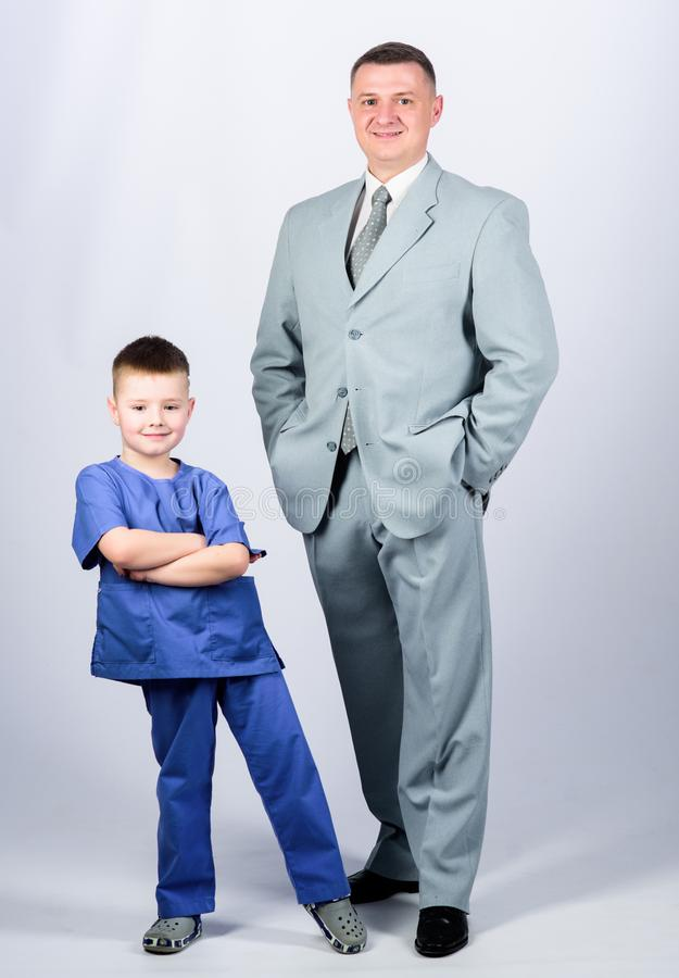 Business partner. small boy doctor with dad businessman. childhood. trust and values. fathers day. family day. father. And son in business suit. male fashion stock images