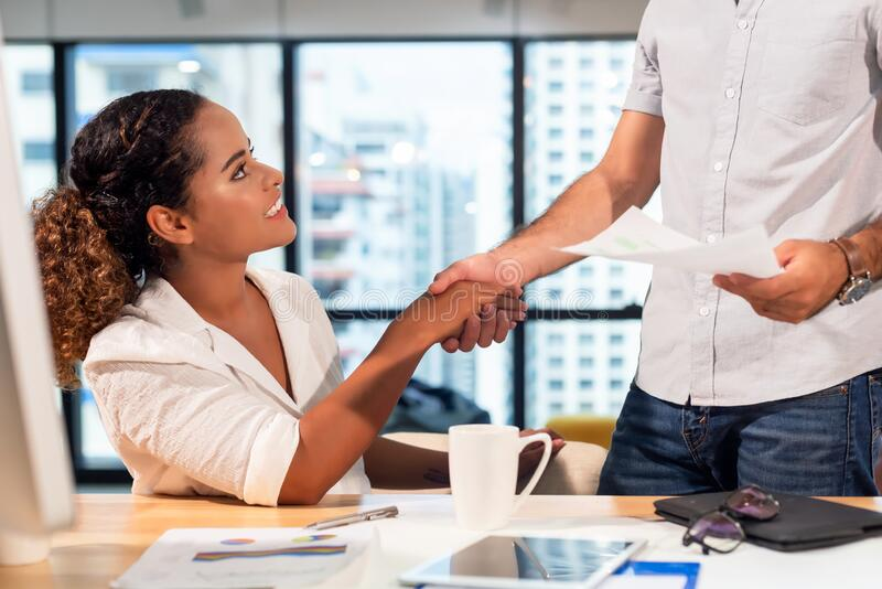 Business partner woman and man joining and stack hand together after contract finished meeting. stock images