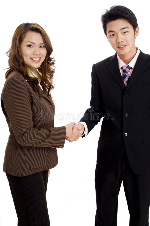 Business Partners. Two good-looking business executives shaking hands royalty free stock photos