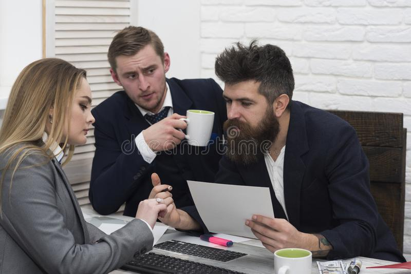 Business partners, businessmen at meeting, office background. Bosses interviewing woman for hiring. Job interview stock photo