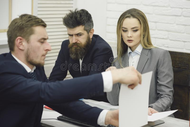 Business partners or businessmen at meeting, office background. Business negotiations, discuss conditions of deal. Woman royalty free stock photography