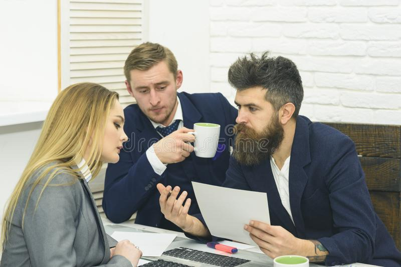 Business partners or businessmen at meeting, office background. Business negotiations, discuss conditions of deal stock image