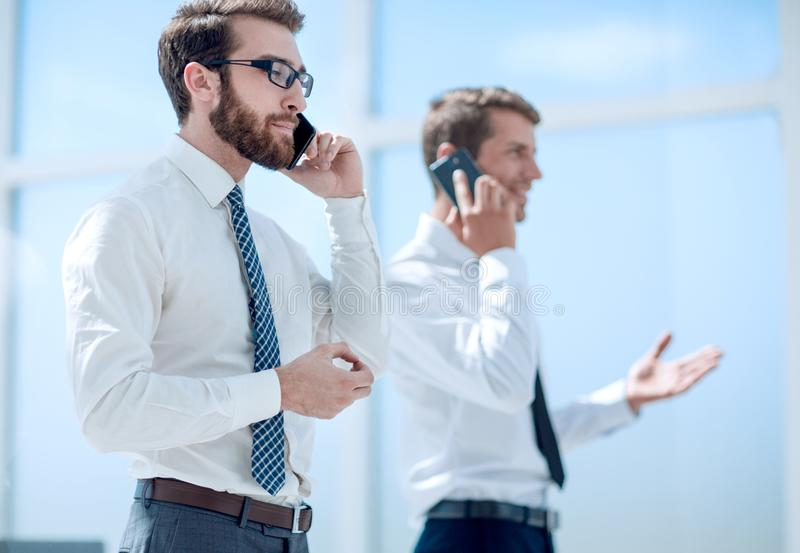 Business partners communicating using smartphones. Business concept stock images