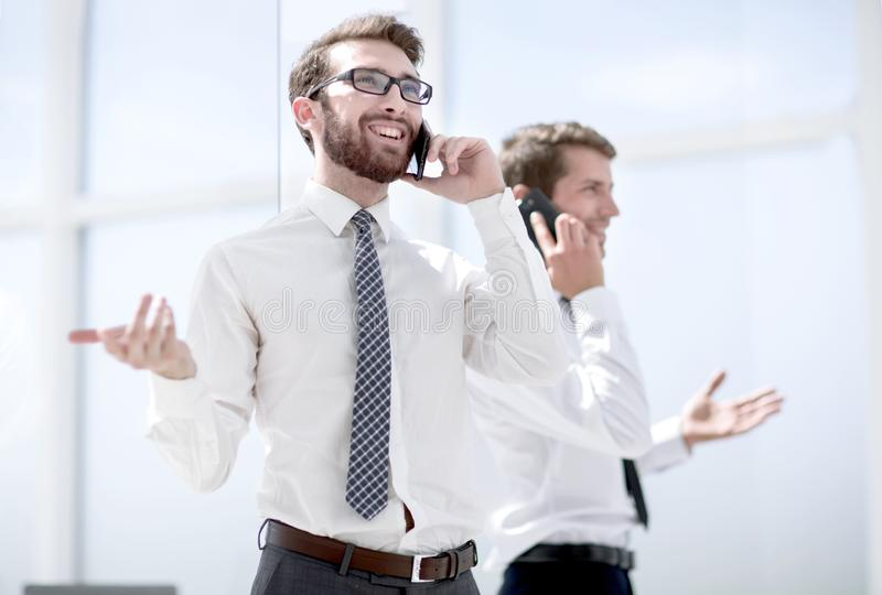Business partners communicating using smartphones. Business concept royalty free stock photography