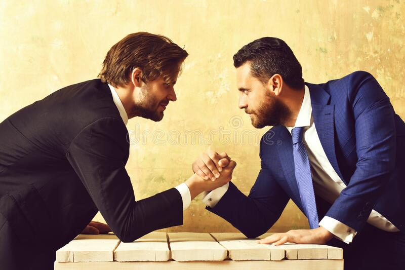 Business partners compete with each other royalty free stock images