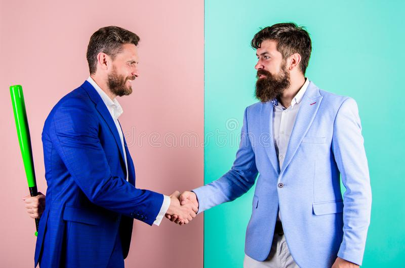 Business partners competitors office colleagues shaking hands. Tricky first impression. Do not trust him. Hidden danger royalty free stock images