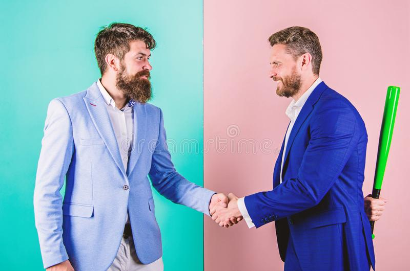 Business partners competitors office colleagues shaking hands. Tricky first impression. Do not trust him. Hidden danger stock photos