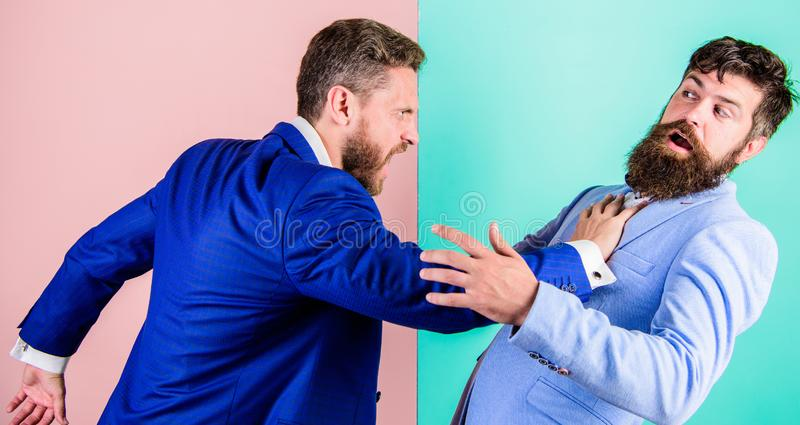 Business partners competitors office colleagues tense faces conflict situation. Business competition and confrontation royalty free stock photos