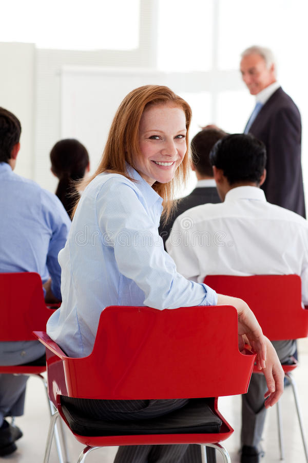 Business partners at a conference. Portrait of business partners at a conference in the office stock photography