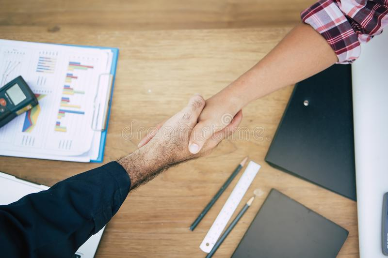 Business partners confirm deal to corporate. Business partners confirm corporation. Young startup businessman shaking hands with Supplier / client after agree a stock image
