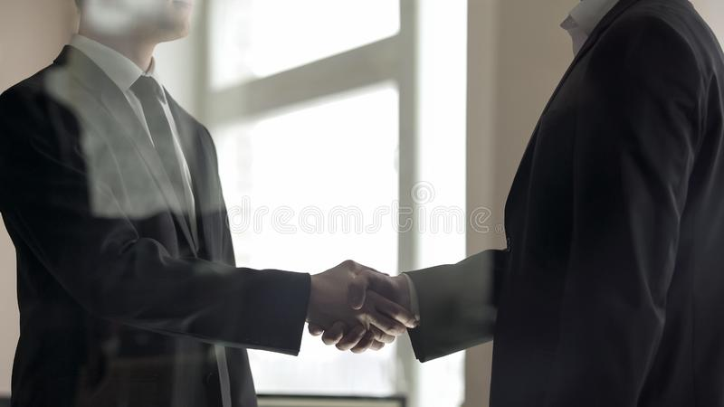 Business partners confirming deal with firm handshake, teamwork, partnership. Stock photo royalty free stock photography