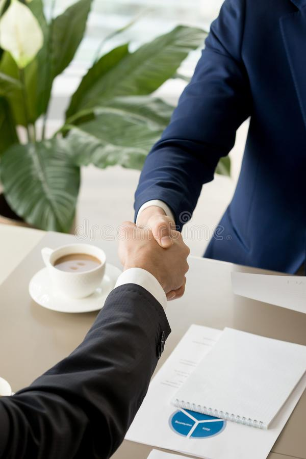 Business partners confirming deal with handshaking royalty free stock photos