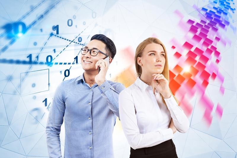 Business partners, digital interface. Pensive blonde businesswoman and her smiling asian colleague standing near white wall with digital interface and flow of royalty free stock image