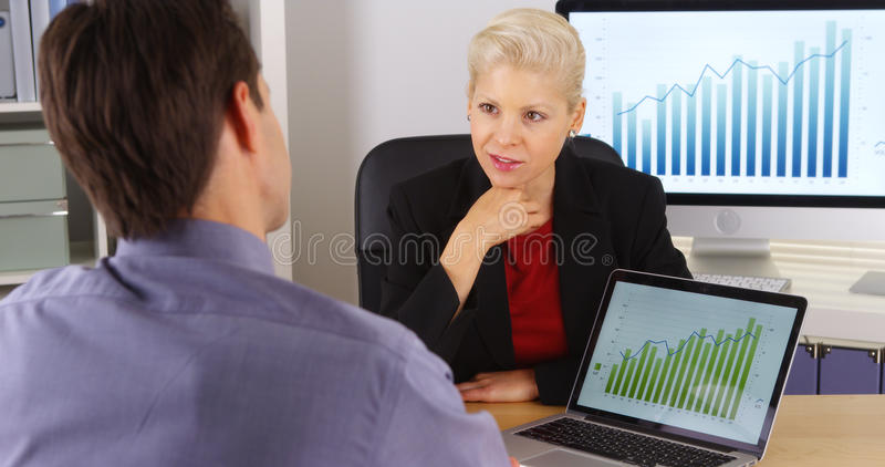 Business partners discussing future marketing ideas stock photos