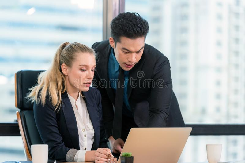 Business partners discussing graph of financial, two people are presented marketing work project to the customer in meeting room o stock photo