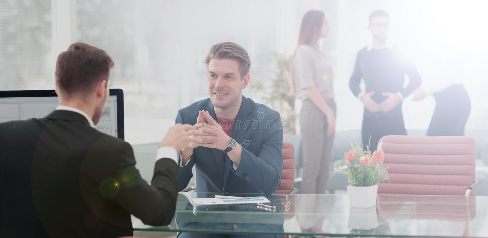 Business partners discussing in meeting hall with their collegue. Business people sitting at corporate meeting stock photo