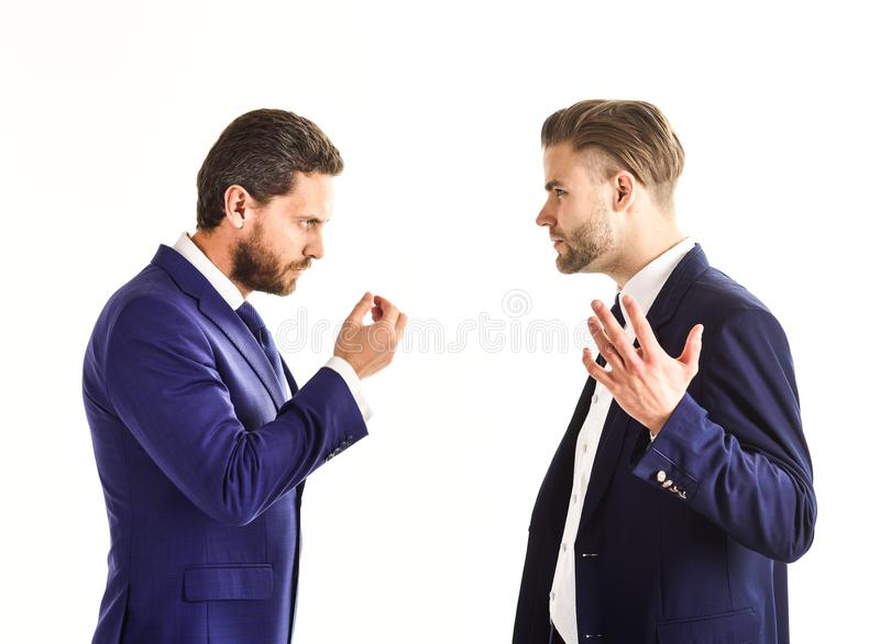 Business partners discussing problems isolated on white backgrou. Nd. Men in suits or businessmen with tense faces and hands expression speaking. Business stock photography