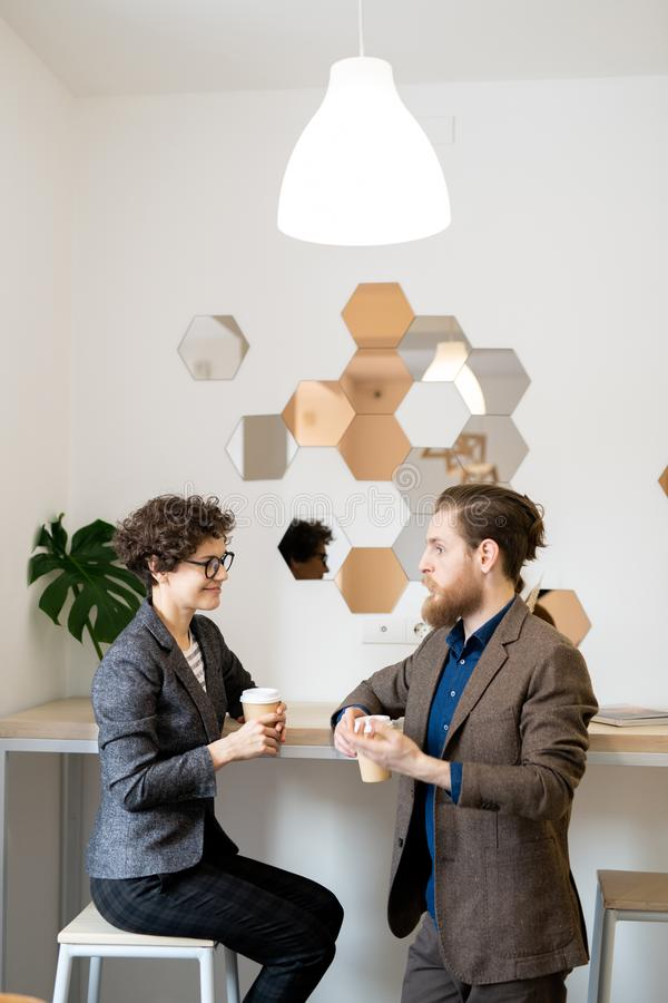 Business partners discussing project development in cafe stock images