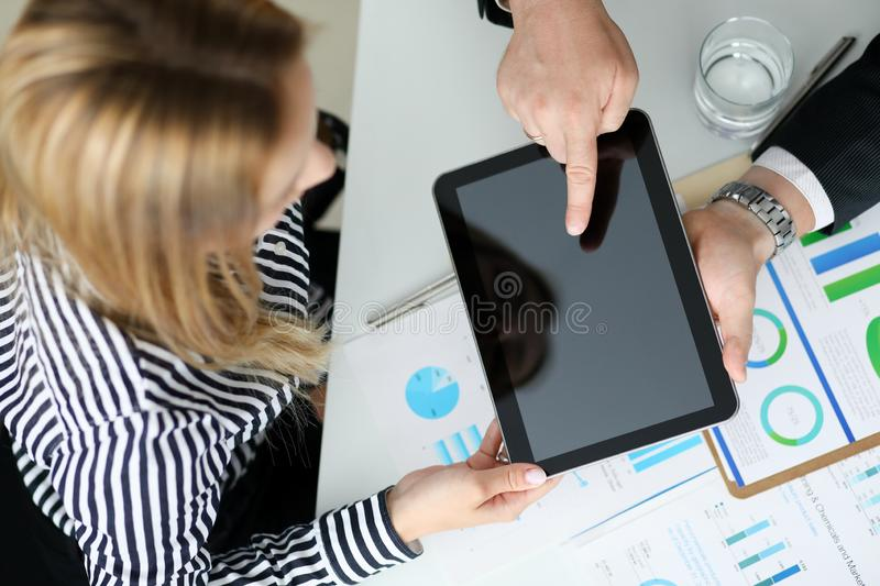 Business partners discussing terms of contract stock photo