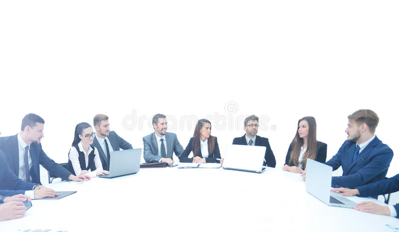 Business partners with documents and laptops sitting around the stock images