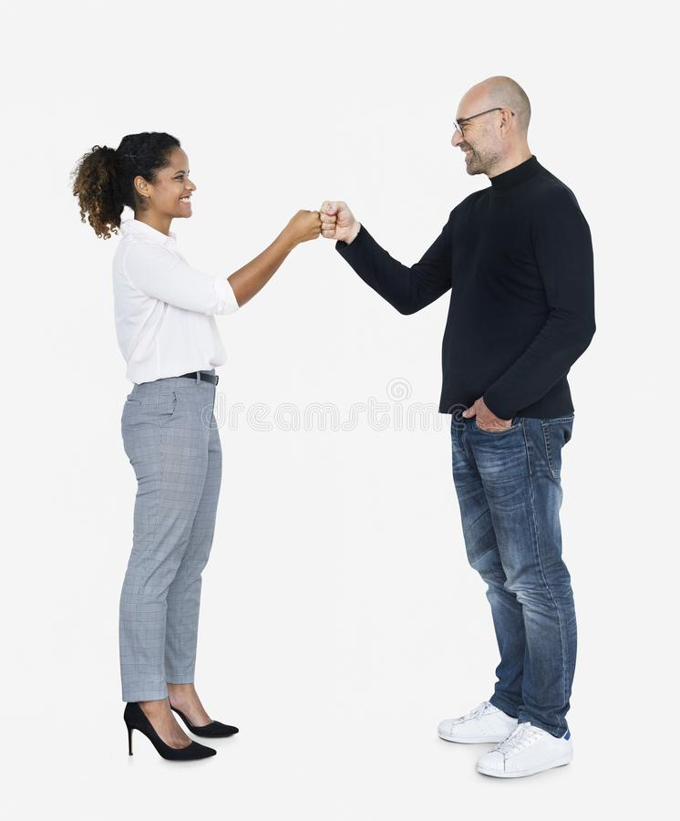 Business partners doing a fist bump royalty free stock image