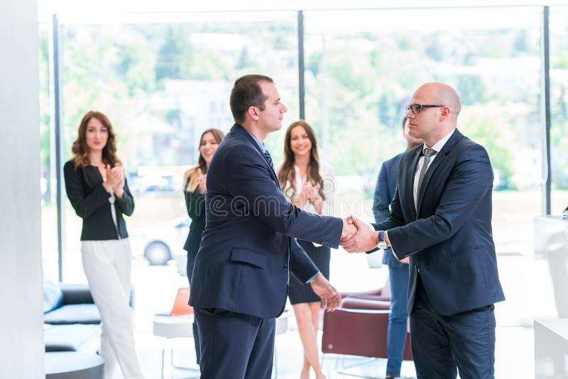 Business partners handshaking after signing contract. Big business deal concluded making everyone happy royalty free stock photography
