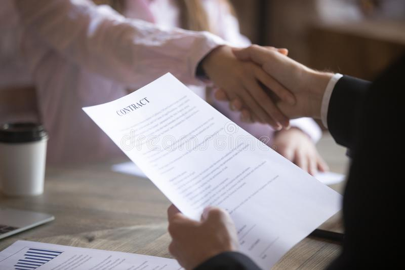 Business partners handshaking after signing a contract. Business partners handshaking signing contract. Deal with good result, start of work with business stock photo