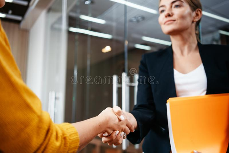 Business partners handshaking after success deal. Positive working moment royalty free stock photography
