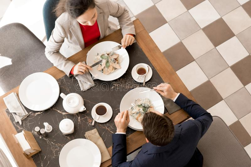 Business partners having dinner together in restaurant royalty free stock photo