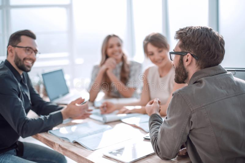 Business partners hold a dispute at a meeting in the office royalty free stock images