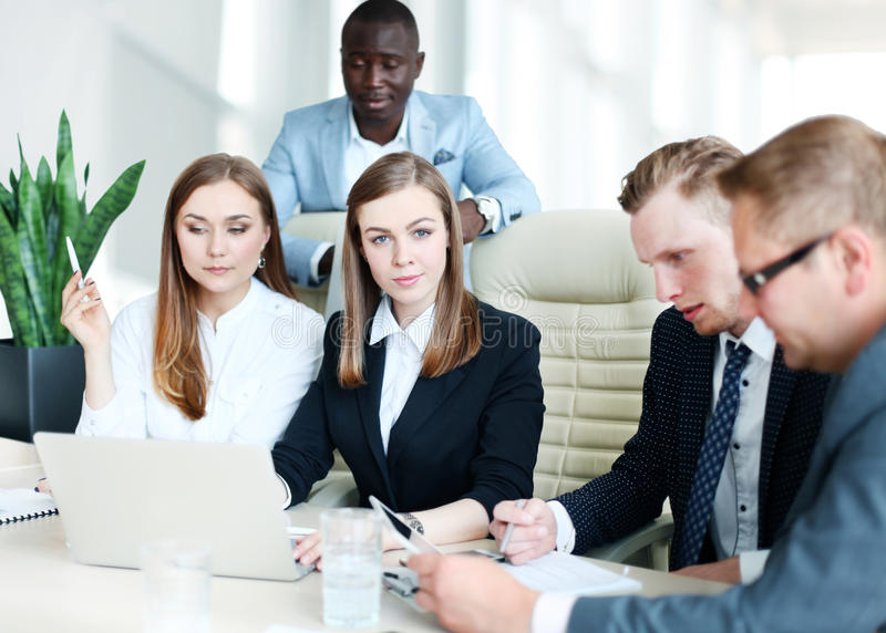 Business partners. Image of business partners discussing documents and ideas at meeting royalty free stock photo