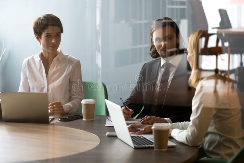 Businesswoman explaining project strategy to colleagues during m royalty free stock photos